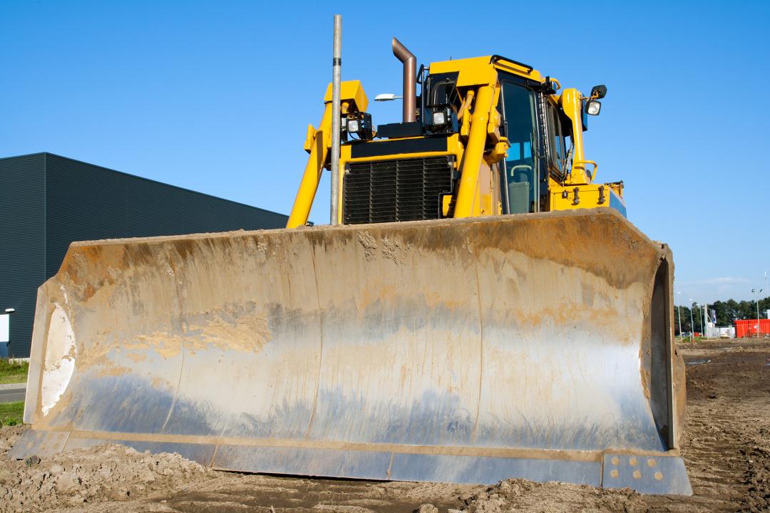 Yellow bulldozer at work